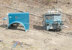 """CHOPPED — Parts of a Peterbilt truck cab were found on a natural gas well site near the community of Jackhorn. Police have arrested two men and a woman they say were operating a """"chop shop"""" operation on the property."""