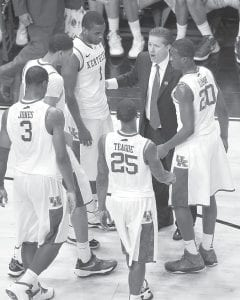UK coach John Calipari talked with his players in the second half of their NCAA tournament game in Louisville. Kentucky beat Iowa State, 87-71, and advanced to play Indiana.(AP photo)