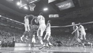 Terrence Jones (3) blocked the shot of Iowa State forward Melvin Ejim (3) in UK's win over Iowa State. (AP photo)