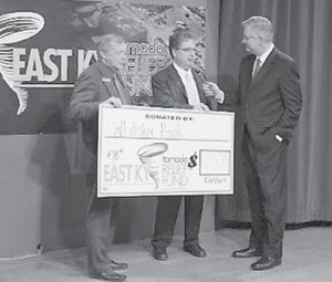 — Whitaker Bank Area President Paul Leon Adams (left) and Regional Manager Larry Adams (center) present funds donated by Whitaker Bank employees from the Letcher/Perry County offices for tornado victims at the Kentucky Tornado Relief Telethon at the WYMT-TV studios in Hazard. At right is Neil Middleton, vice president of news at WYMT.