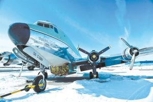"""NEW PROGRAMS — A Buffalo Airways plane rests on a snow covered tarmac in a promotional photo from """"Ice Pilots,"""" airing Mondays at 9 p.m. on The Weather Channel. The Weather Channel is in the midst of a transformation with original programming about Arctic pilots, steel workers, wind turbine and power line repairers and Coast Guard rescuers in both icy and tropical climates. (AP Photo)"""