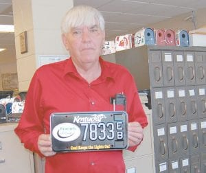 """Letcher County Clerk Winston Meade displayed a """"Friends of Coal"""" specialty license plate in his office in the Letcher County Courthouse on Tuesday. (Photo by Sally Barto)"""