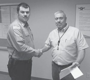 Joe Harris (pictured at right), regional manager of Ferus, recently presented Matthew Corbett, a firefighter with the Jenkins Fire Department, with a check for $2,500 to purchase rescue and fire equipment.