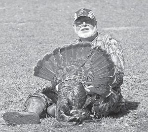 Steve Brewer posed for the photo in Florida after killing the second of two Osceola wild turkeys during a hunting trip there this month.