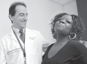 Dr. Francesco Rubino, a surgeon at Weill Cornell Medical Center, joined his patient Tamikka McCray, 39, in New York. McCray no longer needed to take diabetes medication and insulin after her weight-loss surgery. (AP Photo)