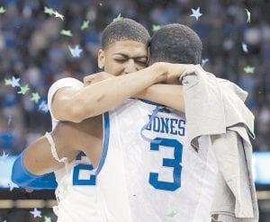 Kentucky forward Anthony Davis hugged forward Terrence Jones (3) after the NCAA Final Four tournament college basketball championship game in New Orleans. Kentucky beat Kansas 67-59. (AP Photo/David J. Phillip)