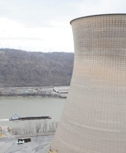 A barge loaded with coal made its way to the Bruce Mansfield Power Station in Shippingport, Pa., recently. (AP Photo/Pittsburgh Tribune-Review, Philip G. Pavely)