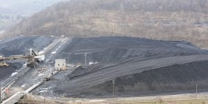 A mound of coal that will be used to power the Bruce Mansfield Power Station is seen in Shippingport, Pa. (AP Photo/Pittsburgh Tribune-Review, Philip G. Pavely)