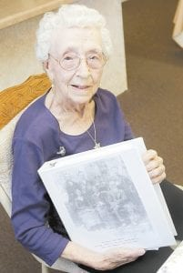 Verla Morris, who will turn 100 later this year, posed for a photo with some of her family census data from the 19th and 20th centuries at her local senior center in Chandler, Ariz. (AP Photo)