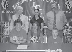 "— Brandy Porter, daughter of Terry and Delisa Cornett, has signed to play lacrosse with University of Pikeville, making her the first Letcher County Central High School athlete to advance in that sport. Pictured at the signing were LCC Athletics Director Arthur ""Ozz"" Jackson, Coach Erica Erb, Porter's mother, Delisa, Porter and her brother, Zachary Cornett."
