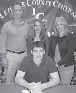 Letcher County Central High School football star Logan Johnson, a standout at quarterback and on defense, has signed to play football with Morehead State University. Surrounding Johnson at a recent signing ceremoney were his father, Mark Johnson, sister Emily Johnson, and mother Kathy Johnson.