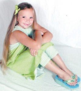 Hannah Click poses in a portrait taken by the Olan Mills studios before she was injured in a go-kart accident in Knott County.