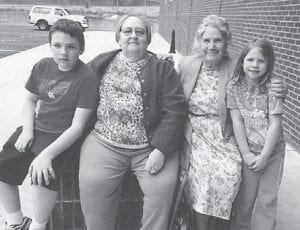 Sam and Ellie Mullins, children of Rich and Angie Hatton Mullins, pose for a picture with their two great-grandmothers, Maggie Cook (left) and Oma Hatton at the new Letcher County Recreation Center. They were attending a birthday party for Kate Hatton, daughter of Andrea and Dr. Jonathon Hatton of Pikeville.
