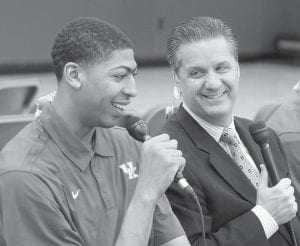 Anthony Davis, left, spoke while Kentucky basketball coach John Calipari listened on Tuesday in Lexington. Freshmen Davis, Michael Kidd-Gilchrist and Marquis Teague, and sophomores Terrence Jones and Doron Lamb declared for the NBA draft in a nationally televised news conference. (AP Photo/The Courier-Journal, James Crisp)
