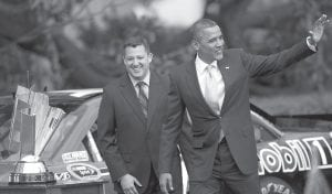 President Barack Obama, right, walked with NASCAR Sprint Cup Series champion Tony Stewart during an event to honor him and the other 2011 Sprint Cup Series drivers at the White House on Tuesday in Washington. (AP Photo/Evan Vucci)