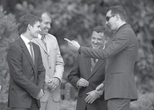 Tony Stewart , third from left, talked with, from left, Jeff Gordon, Ryan Newman, and Kyle Busch after the event at the White House on Tuesday. (AP Photo/Evan Vucci)