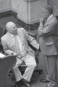 Senate Democratic Caucus Chair Johnny Ray Turner, D-Drift (left), speaks with Sen. Gerald Neal, D-Louisville, during a recess period in the Kentucky Senate. (LRC Public Information)