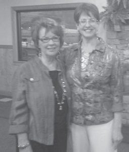 Karen Butcher (right), director of Educational Development for Whitaker Bank, is pictured with Brenda DePriest of the Letcher County Chamber of Commerce at a motivational breakfast held recently at Pine Mountain Grill.