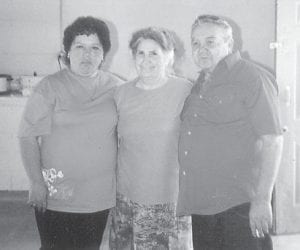 — Brenda and Dexter Howard are pictured with Whitesburg correspondent Oma Hatton (center) at a Howard family reunion in Garret, Ind., a few years ago.