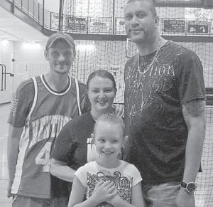 — Ruthie Lee and her mother and father, Jessie and Rocky Lee, met University of Kentucky legend and NBA Slamdunk champion Kenny 'Sky' Walker at the Letcher County Recreation Center April 19.