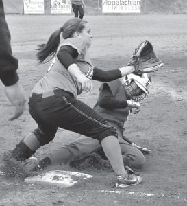 Letcher Central's Cheyenne Stidham slid safely into third base while Jenkins's Mercedes Boggs waited to receive the throw from home plate during the Lady Cavs' win. (Photo by Chris Anderson)