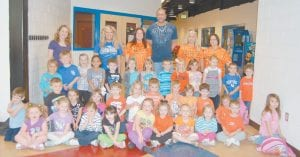 The preschool classes at West Whitesburg Elementary School visited the Letcher County Recreation Center on April 19 and posed for a photo with former University of Kentucky basketball player Kenny Walker. Pictured are (front row, left to right) Allie Bailey, Sophia Hogg, Brianna Boggs, Kayla Potter, Briley Hall, Ebony Richardson, Kylie Williams, Allie Spencer, Parker Richardson, Kylee McNeely, (second row) Ian Adams, Garrett Howard, Marlee Collins, Brooke Lucas, Matthew Muncy, Paige Napier, Tucker Watts, Jett Outlaw, Heather Crawford, Harrison Addington, Madison Potter, (third row) Alexas Holbrook, Sam Webb, Amella Lucas, Sienna Osley, Nate Adams, Addy Allman, Victoria Callahan, Luke Miller, Railyn Addington, Scarlett Stamper, Jaleigh Wright, Jaycob Stallard, Karlee Hensley, Ms. Angela, Ms. Brooke, Ms. Melissa, Kenny Walker, Ms. Connie, and Ms. Heather.
