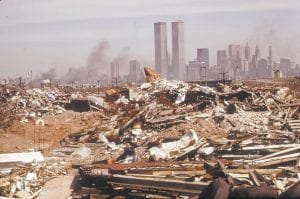 THEN — This March 1973 photo released by the U.S. National Archives shows an illegal dumping area off the New Jersey Turnpike. The site faced Manhattan across the Hudson River and north of the landfill area of the proposed Proposed Liberty State Park, N.J. (AP Photo/U.S. National Archives, Gary Miller)