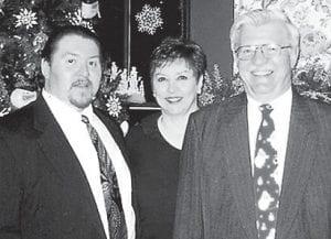 Bruce and Diana Preston are pictured with his father, John Preston.