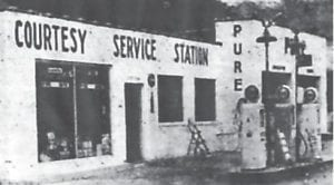 This photograph of the Courtesy Service Station appeared in the April 9, 1953 issue of The Mountain Eagle. Hubert Hall and Billy Wayne Wright were operating the station, located behind the Elinda Ann Drive-Inn Theatre. The station was open from 7 a.m. to 10 p.m., and contained the only Wash- Mobile in the county.