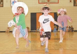 — West Whitesburg Elementary School preschool students galloped to the finish line on stick ponies Tuesday afternoon in the Whitesburg Middle School gymnasium. Pictured from left are Scarlett Stamper, Harrison Addington and Madison Potter. Harrison won the big race, which was held in honor of the 138th renewal of the Kentucky Derby, which will be held Saturday at Churchill Downs on Louisville.