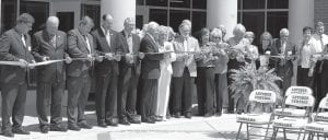 Those pictured cutting ribbon at a ceremony celebrating the completion of the new Letcher County Area Technology Center are (from left) Bob Tarvin representing the Kentucky Department of Education, State Sen. Johnny Ray Turner, Letcher Judge/Executive Jim Ward, State Rep. Rocky Adkins, Joe Meyer, cabinet secretary for education and workforce development, Gov. Steve Beshear, Letcher Schools Supt. Anna Craft, Letcher Board of Education Chairman Will Smith, Barbara Isom, former principal of the Letcher County Area Technology Center, Sandy Hogg, director of special programs for Letcher Public Schools, Letcher School Board Member Dr. Sam Quillen Jr., State Rep. Leslie Combs, Jenkins Independent Board of Education Member Paulette Sexton, Jenkins School Board Member Eileen Sanders, Letcher County School Board Member John Spicer, Linda Floyd, area supervisor for the office of career technology, and David Lee, principal of Jenkins High School.