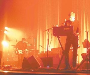 Members of Death Cab for Cutie were bathed in orange stagelights when they performed recently at Louisville's Palace Theatre.