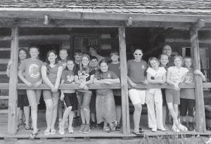 The Cowan Elementary School academic team recently made a trip to the Mountain Homeplace Clinic and the Country Music Highway Museum. Pictured on the front porch of an old house are (left to right) Jeanna Roark, Haley Banks, Laken Caudill, Sandara Baker, Destiny Eldridge, Shannon Adams, Olivia Hammock, Airies Mullins, Bethanie Monroe, Gracie Ramey, Kenzie Adams, Hannah Caudill and Zack Cornett. In back is Coach Gary Sturgill.