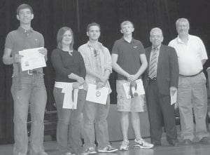 — The Letcher County Chamber of Commerce presented certificates and medallions to students who completed the Chamber's Work Ethic program. From left to right are Trevor Adams, who received a $1,000 scholarship; Kaitlyn Collier, who received a $500 scholarship; Kevin Collier; Phillip McCray; Chamber President Joe DePriest, and Reed Caudill of Community Trust Bank. Ferus Corp. was a sponsor of the program.
