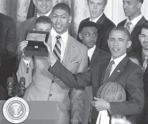 BIG WEEK FOR DAVIS, TEAMMATES — President Barack Obama accepted a ring on May 4 from forward Anthony Davis, right, as he held a basketball and jersey given to him by the University of Kentucky men's basketball team in the East Room of the White House during a ceremony to celebrate their 2012 NCAA Championship. (AP Photo)