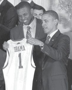 President Barack Obama, right, accepted a jersey from Kentucky guard Darius Miller at the White House during a ceremony celebrating the 2012 NCAA Championship for the men's college basketball team. (AP Photo)