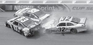 Landon Cassill (83), Carl Edwards (99) and Terry Labonte (32) collided in Turn 2 during the NASCAR Sprint Cup Series auto race at Talladega Superspeedway. (AP Photo)