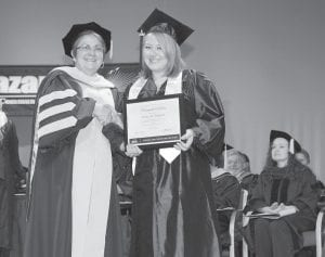 — Hazard Community and Technical College honored Shelly Parrott of Whitesburg with the Distinguished Scholar Award for Associate in Applied Science degree presented during commencement by Dr. R. Kathy Smoot, Provost and Vice President of Academic Services. Parrott received this award for having a perfect 4.0 grade point average in her classes. Her major was General Occupational/Technical Studies with a Diploma in Computer Aided Drafting and Design.