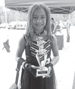 """Sidnie Watts, daughter of Kelly Watts, formerly of Mayking, granddaughter of Larry and Diane Watts of Mayking, was the third-place winner at the Jacksonville Jamboree Talent Show in Jacksonville, N.C. The event took place April 21. Sidnie was selected as one of 10 finalists and competed against contestants of all ages singing """"So What"""" by P!nk. She loves singing and being on stage and plans to continue competing in talent shows in the future."""