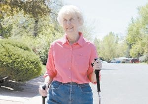Elaine Vlieger, 79, walked recently near her home near Denver, Colo. Vlieger is making some concessions to her early stage Alzheimer's, but isn't ready to give up either her home or her independence. She stays active with yard work and daily walks. (AP Photo)