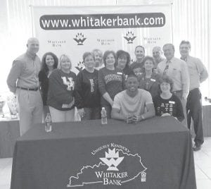 DARIUS MILLER, a player on the University of Kentucky Wildcats championship team, and his manager, former UK player Jeff Sheppard, visited the Main Office of Whitaker Bank in Whitesburg on April 25. Miller signed autographs and posed for photos for UK fans.