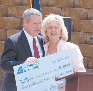 Barry Caudill, representing Community Trust Bank of Whitesburg, delivered a contribution of $20,000 to Supt. Anna Craft.