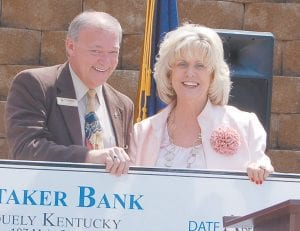 Paul Leon Adams,representing Whitaker Bank of Whitesburg, presented a check in the amount of $20,000 to Supt. Craft.