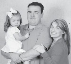 Dr. Jonathan and Andrea Hatton are pictured with their daughter, Kate.
