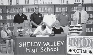 Lucas Fields, a running back for Shelby Valley High School, signed a letter of intent to play football for Union College. During his senior year, Fields rushed for more than 1,800 yards averaging 181 yards a game. He is ranked the number one running back in Division 2A in Kentucky. Pictured with Fields are Taylor Fields, Yvonne Day, Trula Fields, Daughty Day, Coach Michael Roberts, Tim Fields, Coach Aaron Stepp, Coach Anthony Hampton and Principal Greg Napier.
