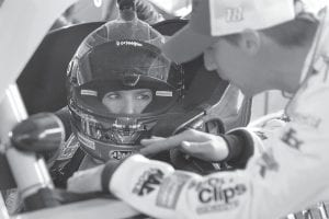 NASCAR driver Danica Patrick, left, listened to Denny Hamlin after she took her first laps at Darlington Raceway during practice for a Nationwide Series auto race in Darlington, S.C. (AP Photo)