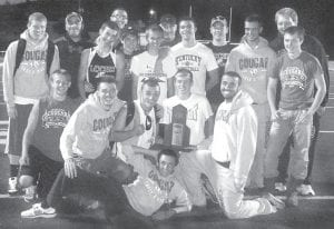 Members of the Letcher County Central High School boys' track team celebrated after winning the regional title. Pictured are (front) Austin Bolling, (second row) Chippy Frazier, Matt Boggs, Drew Bently, Bobby McKenzie, Jake Dixon, (standing) Trenton Whitaker, Sidney Fields, Dylan Burton, Izak Dyal, Colton Collins, Chase Cates, Joe Moore, Keaston Hall, Ryan Hampton, Jermiah Stidham, Willie Smith and Josh Boggs.