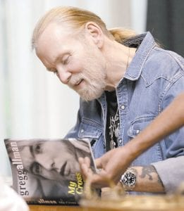 """Gregg Allman, founding member of The Allman Brothers Band, signed copies of his autobiography """"My Cross to Bear"""" on May 10 in Nashville, Tenn. (AP Photo/Mark Humphrey)"""