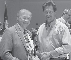 """Whitaker Bank President Paul Leon Adams (left) is pictured with Tim Farmer, host of """"Kentucky Afield"""", the nation's longest running outdoor television show. Farmer joined the show, which is in its 56th year, in 1995 and has won several local and national broadcasting awards along with two Emmys as host and executive producer. He has been nominated for an Emmy again this year."""
