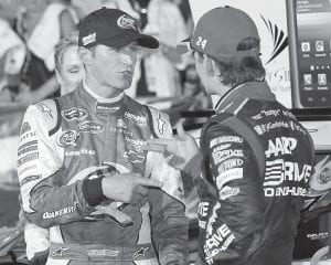 Teammate Jeff Gordon (right) congratulated Kasey Kahne Sunday after Kahne got his first win for Hendrick Motorsports, an organization which has been unstoppable of late in NASCAR's Sprint Cup division. (AP)